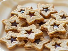 Linzer Star Sandwich Cookies  Alex sandwiches raspberry jam in between two buttery star-shaped cookies to make this festive holiday treat that'll be the centerpiece of your dessert spread.