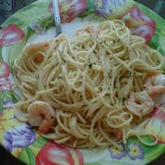 I sautee my shrimp with butter, olive oil and garlic. I season with a bit of fresh ground pepper and oregano. I use angel hair pasta. After it's cooked and drained, I add it to the saute pan for a minute or two, then put it all on a plate and sprinkle with shredded parmesan.