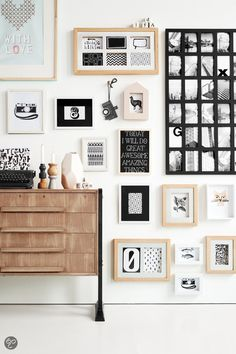 Although I don't have a lot of wall space, I do like to make what I do hang interesting in the arrangement as well.