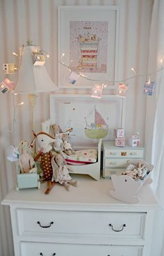 I like the idea of setting up some doll furniture on top of a dresser... simple and accessible, yet out of the way of feet and babies!