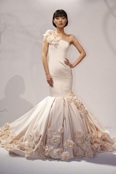 15 Attention-Grabbing Gowns from the Fall 2013 Bridal Shows: Dennis Basso: For the bride who likes her mermaid tails to be extra mermaid-y.