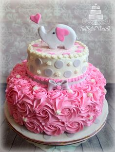 Pink and grey come together for this perfectly cute elephant themed baby shower cake.