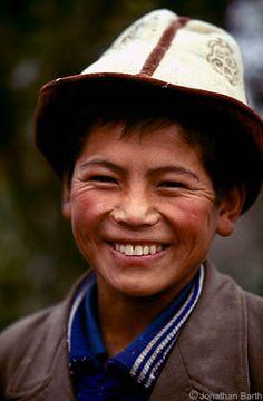 J.Barth photo: a Kyrgyz smiling boy with a traditional Kyrgyz hat (called kalpak in Kyrgyz) on