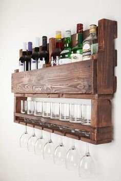 This wine rack from reclaimed wood is a perfect gift for men, birthday gift  or a  housewarming gift. It  would look amazing in a cigar bar or next to your alcohol collection at home or office. If you are a wine and whiskey lover, this is the perfect match for you! This is another fabulous creative addition of Apt8 Ecodesign!  has eight bottle, 7 glass and low balls wine rack is made from reclaimed pallets. This is a fabulous way to display your love for wine. We are happy to take cust..