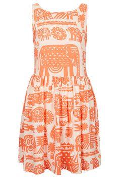 i love how vintage this print feels... plus, it's orange and has elephants!