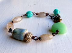 Handmade golden rutile quartz, lampwork glass and handwoven glass bracelet, in opal mint green and pale sand-gold - Songbead UK, art jewelry