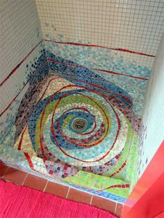 Whoa! Awesome creative vortex shower tile! Re-pinned by www.modwalls.com