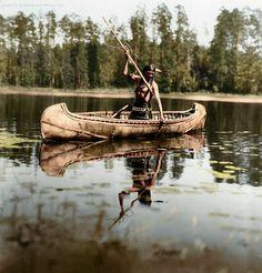An Ojibwe Native American spearfishing, Minnesota, 1908.