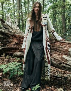 The model lounges Brunello Cucinelli sweater and pants with Valentino coat