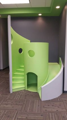 Here is our funky, modern, waiting room playhouse in green. Playhouse With Slide, Kids Playhouse Plans, Kids Indoor Playhouse, Backyard Playhouse, Build A Playhouse, Modern Playhouse, Indoor Playground, Office Waiting Rooms, Dental Office Design