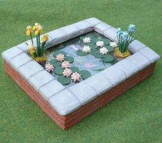 Fish pond for dollhouse garden by Blue Kitty Miniatures, via Flickr