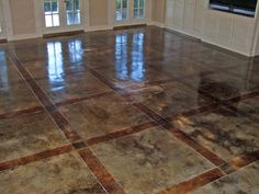 Stained concrete floors...I wouldn't do something this fancy but I really like the idea of having dark teal stained concrete floors with radiant heating in my make-believe house.