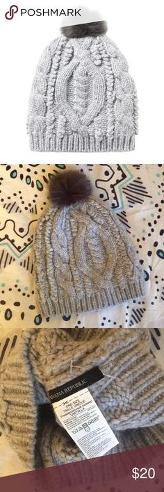 NWOT BR Cable Knit Pom Beanie Chunky knit pom beanie from Banana Republic. Light heather gray body with blackish gray faux fur pom pom. NWOT, perfect condition. Make an offer! 😊 Banana Republic Accessories Hats