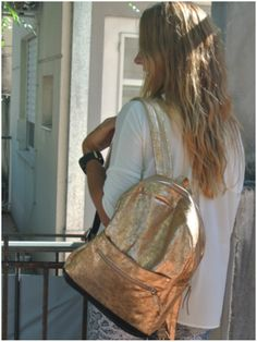 Mar gold leather backpack  www.facebook/pasionargentina