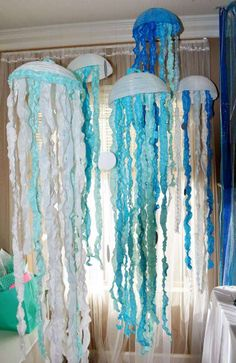 Jellyfish decorations at a pirates and mermaids birthday party! See more party ideas at CatchMyParty.com!
