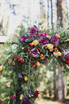 Bright whimsical wedding ceremony arbour flowers