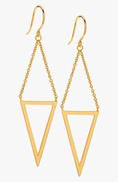'Mika' Drop Earrings at Nordstrom.com. Gilded chains carry the slick triangle cutouts of a pair of ultra-mod drop earrings that boast surprising versatility.