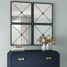 This set of 4 wall mirrors can be hung horizontally or vertically, alone or together – yes, it's *that* versatile! Crafted from iron and mirrored glass, each panel features a four-triangle windowpane pattern with a subtle center spiral for a touch of texture. The black iron finish makes this design ideal for pairing with a variety of aesthetics. Since there's four pieces, you can add them all in one room or spread them throughout the house. Prediction: You'll love having this many styl Set Of 4 Wall Mirrors, Wall Mirror Online, Black Wall Mirror, Mirror Set, Wall Mounted Mirror, Frames On Wall, Framed Wall, Mirror Gallery Wall, Beveled Glass