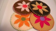 Simple coasters using cd's, embroidery floss and felt.  Cut felt circles slightly larger than a cd.  Applique chosen design on one side using whipstitch (or stitch of choice).  Place cd between two felt circles and blanket stitch around the perimeter.
