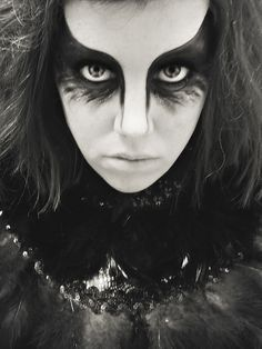 A great idea for raven costume eye makeup; apply this simple design for a crow Halloween costume as well!