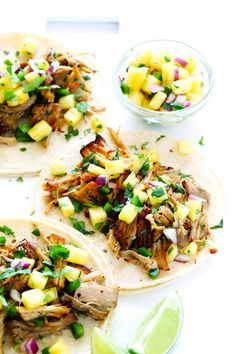 These tasty Instant Pot Carnitas are tossed with a pineapple salsa, and marinade with a delicious citrus mojo sauce! | gimmesomeoven.com