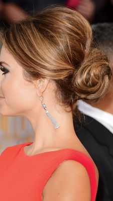 Sleek chignons. Ballerina buns. Romantic braids and twists. We're obsessed with these wedding-worthy
