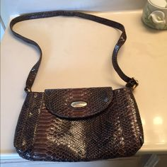 Italian handbag Approximately 12 W 6h. Brown handbag can be used as a crossbody purse. Used only once.Has zipper in back for keys etc. Bags