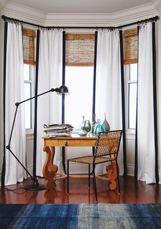 crisp white drapes around windows and we could edge them in fabric or add simple fabric band on the bottom.  Very similar shades to what you currently have