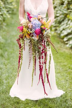 Bohemian cascading bouquet. Love Lies Bleeding. Pheasant feathers. Ivy and Aster Anemone