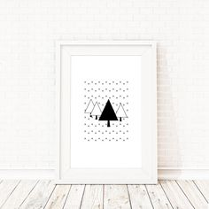 Let it snow, let is snow, let it snow! Beautiful Scandinavian winter themed poster by Black & Boo Design which would look so cute as nursery wall art. But these black and white evergreen trees will give any room in your house a crisp and serene look.  Snow covered Pine Trees Print | Scandinavian Winter Themed Poster | Baby Room Wall Art | Tree Art Prints for Sale | Evergreen Trees Winter