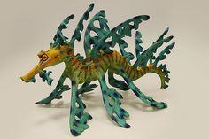 The making of a Leafy Sea Dragon by ceramic sculptor Julian Jardine. Pottery Animals, Ceramic Animals, Clay Animals, Leafy Sea Dragon, Clay Fish, Sea Life Art, Dragon Artwork, National Art, Horse Sculpture