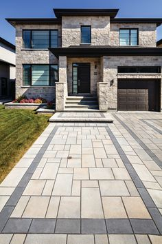 This stone walkway was inspired by our Blu Collection, the perfect driveway paver to fit any modern home's exterior! If you're looking to add contrast around this subtle and clean paving stone, the Blu 6 × 13 mm can be added to create contrasting patterns or banding along the modular pattern! Stone Walkway, Paving Stones, Landscape Pavers, Landscape Design, Home Landscaping, Front Yard Landscaping, Walkways, Contrast, New Homes
