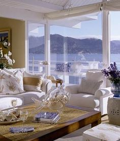 Neutral space is just the background for the blue of the water & sky. Very inviting!  Coastal living