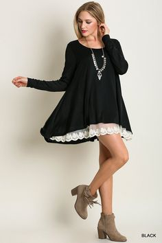 A black long sleeve knit top with a lace detail.   65% Cotton 35% Polyester Hand Wash Cold Wash Imported  Size Fits:Small- 0-4; Medium- 6-8; Large- 10 Size Fits: XL- 12-14; 1X- 16-18; 2X 20-22