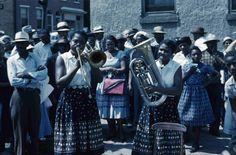 """1958, Big August Quarterly is an annual religious festival held in Wilmington, Delaware.  Begun in 1814 by Peter Spencer in connection with the """"quarterly"""" meeting of the African Union Church.  It was a time for free blacks and slaves alike to come together and celebrate their faith with singing, dancing, and feasting. It is the oldest such celebration in the country.  From the Slide/Wilmington Churches Collections at the Delaware Public Archives.  www.archives.delaware.gov"""