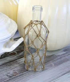 DIY Knotted Jute Net Bottles | Wayfair Add a nautical touch to any room with this knotted jute bottle DIY.