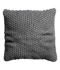 Moss-stitch cushion cover with woven cotton backing and concealed zip. Size 20 x 20 in.