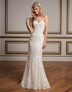 A straight gown with a sweetheart neckline, Alencon lace over point d'esprit tulle, finished hem lace and chapel length train. A detachable tulle train with flower embellishments make this classic silhouette versatile. http://goo.gl/xMrb0V