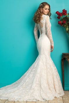 Allure 9260 | We can't decide if we love the front or back of this gown the most: beautiful scalloped lace edges the neckline, while a sheer illusion panel accents the back.   Gown available in White, Ivory, Baby Pink/Ivory  *Pictured in Baby Pink/Ivory  Gateway Bridal | Utah Wedding Dress | SLC | Wedding Inspiration | Wedding Dress Goals | Dream Wedding