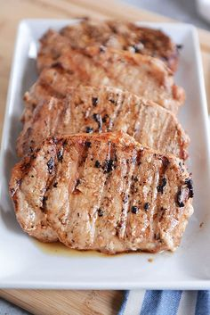 With three simple ingredients in the marinade, these tender grilled pork chops are bound to become a summer (or year-round!) favorite! #porkchops #meat #grilled #melskitchencafe