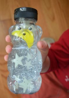 Good Night Moon sensory bottle.I would add other shapes from the book, clear glitter glue to make it move slower. Cute activity for a favorite book!