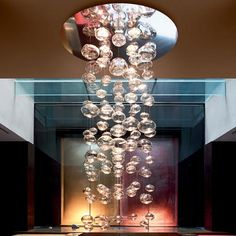 Illuminated, suspended from ceiling