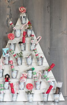 probably could NOT love this more: buckets on a wooden triangle/Christmas tree for an advent calendar.