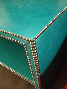 I have to figure this studded turquoise coffee table out.   DIY
