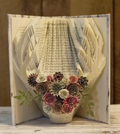 Rustic meets chic with this deer antler book art. Love this beautiful paper flower crown! Paper Flower Arrangements, Paper Flowers, Rustic Chic, Rustic Decor, Bookshelf Inspiration, Paper Crowns, Reading Pillow, Unique Gifts For Men, Deer Antlers