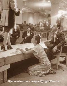 Neiman-Marcus---1945--Stanley-Marcus-observes-catwalk-model