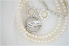Beautiful pearls surround the bride's wedding ring.