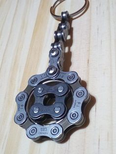 Very exclusive keychain with moving part in center. Made of parts of a shimano HG 54 chain and a conneX chain, the side part was riveted again. Bicycle chain art work by chainworkaronge in Málaga, Spain Welding Art, Welding Projects, Recycled Bike Parts, Garage Art, Scrap Metal Art, Bike Chain, Metal Toys, Bicycle Art, Metal Working