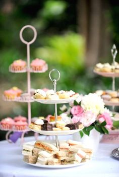 Tea party serving dishes with sandwiches, cupcakes, and tartlets perfect for high tea time. Plan your next tea party with all these handy details.