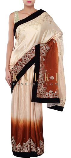 Buy Online from the link below. We ship worldwide (Free Shipping over US$100) http://www.kalkifashion.com/shaded-saree-in-cream-and-brown-embellished-in-kundan-embroidery-only-on-kalki.html